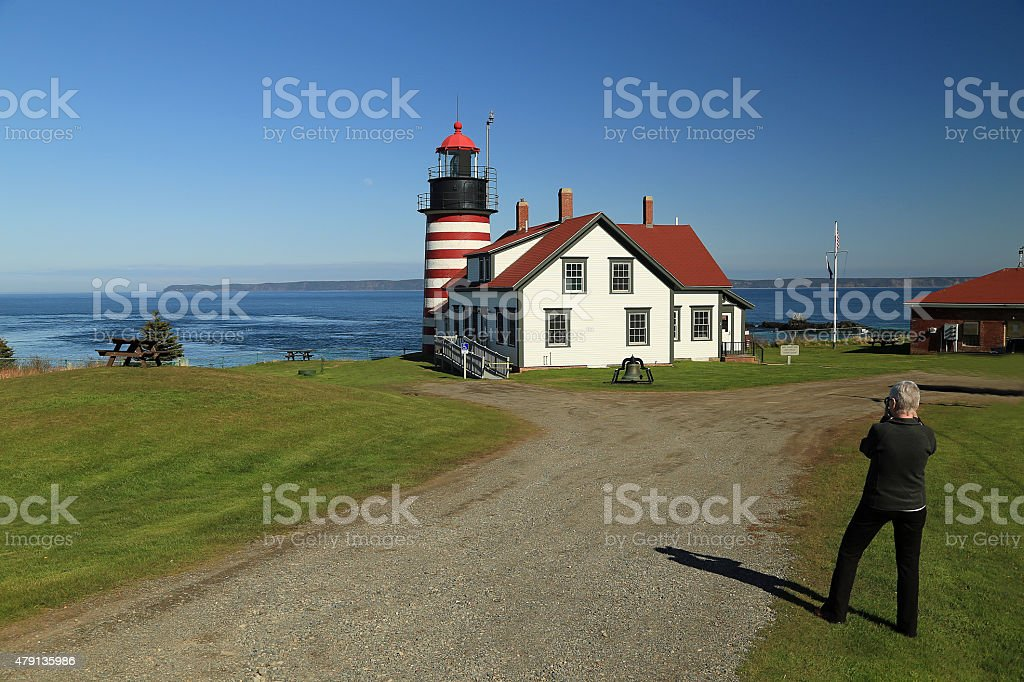 Senior Photographing Lighthouse stock photo