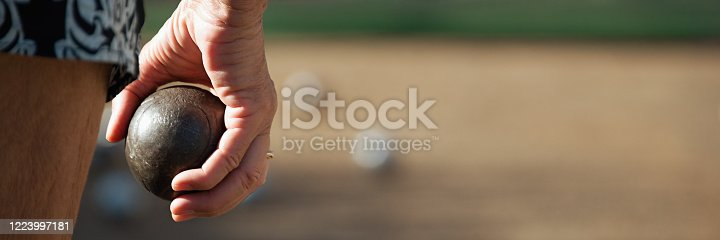 istock Senior playing petanque fun and relaxing game 1223997181