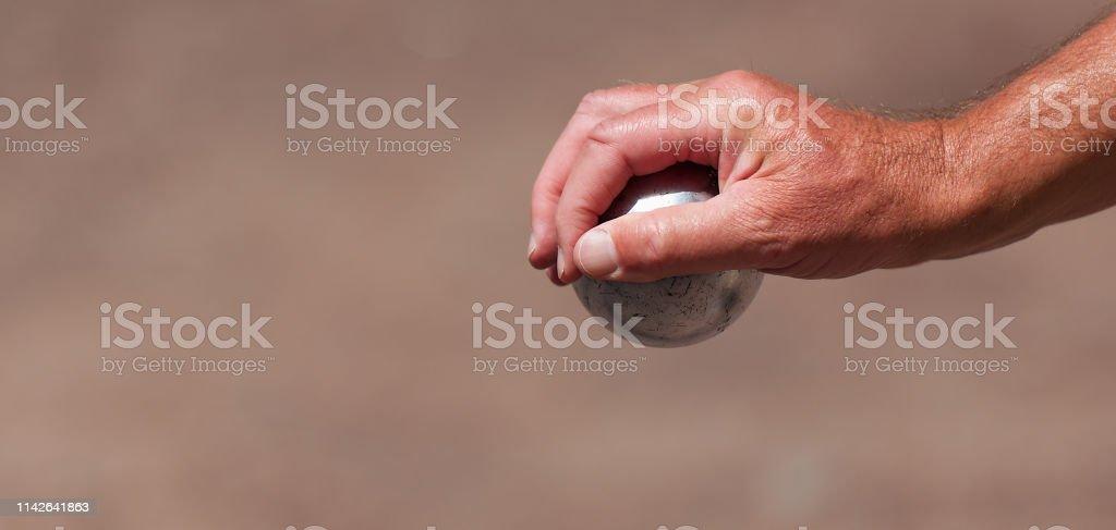Senior playing petanque stock photo