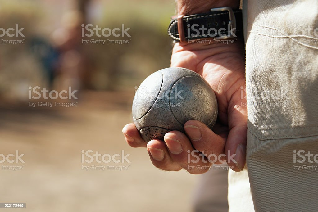Senior playing petanque stock photo