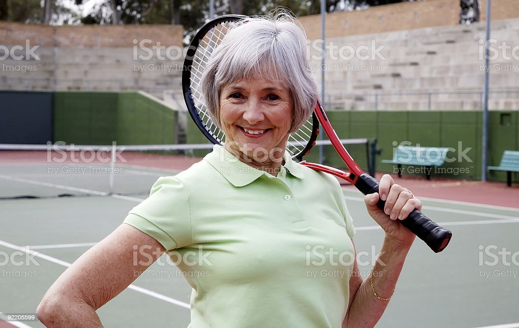 Senior Playing Tennis royalty-free stock photo