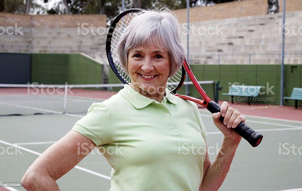 Senior Playing Tennis stock photo