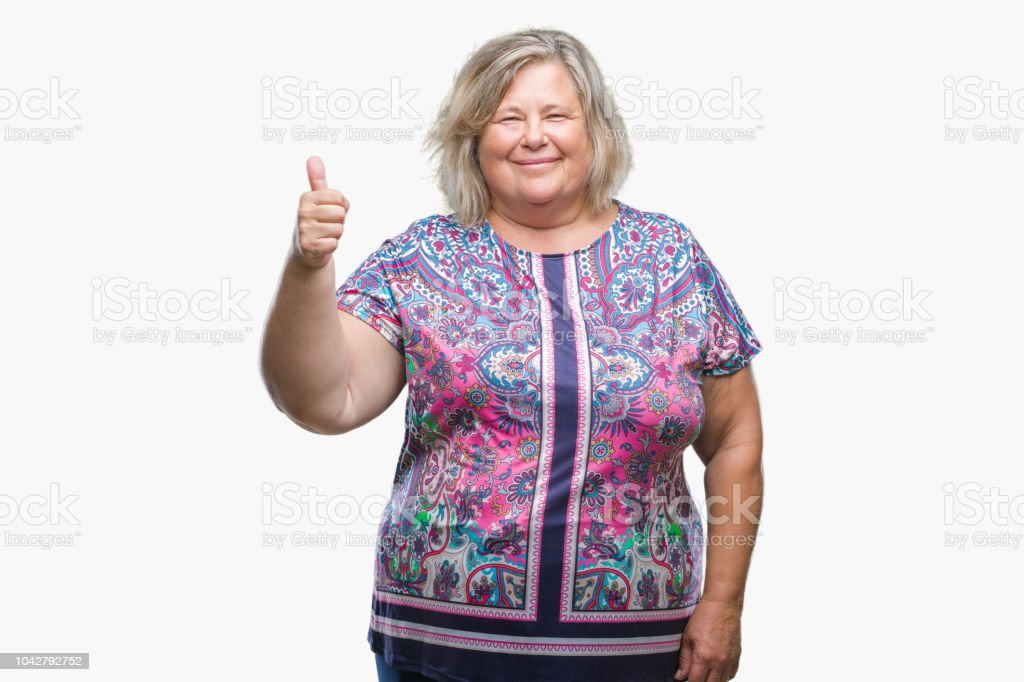 e4ae4208f2f Senior plus size caucasian woman over isolated background doing happy  thumbs up gesture with hand.