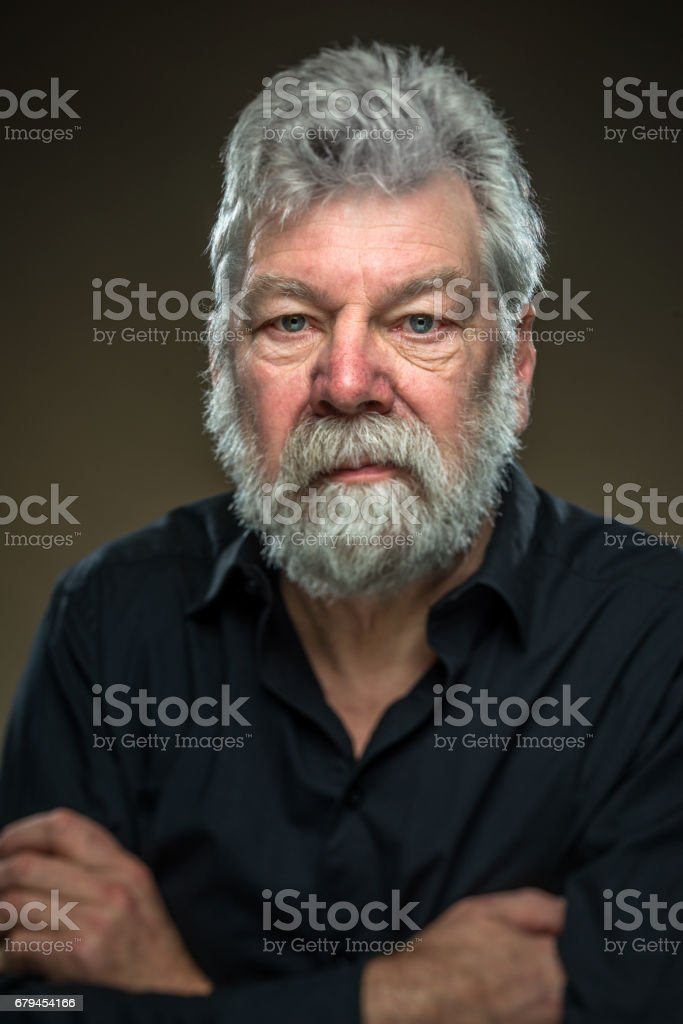 Senior portrait. Real man with beard, looking straight in camera royalty-free stock photo