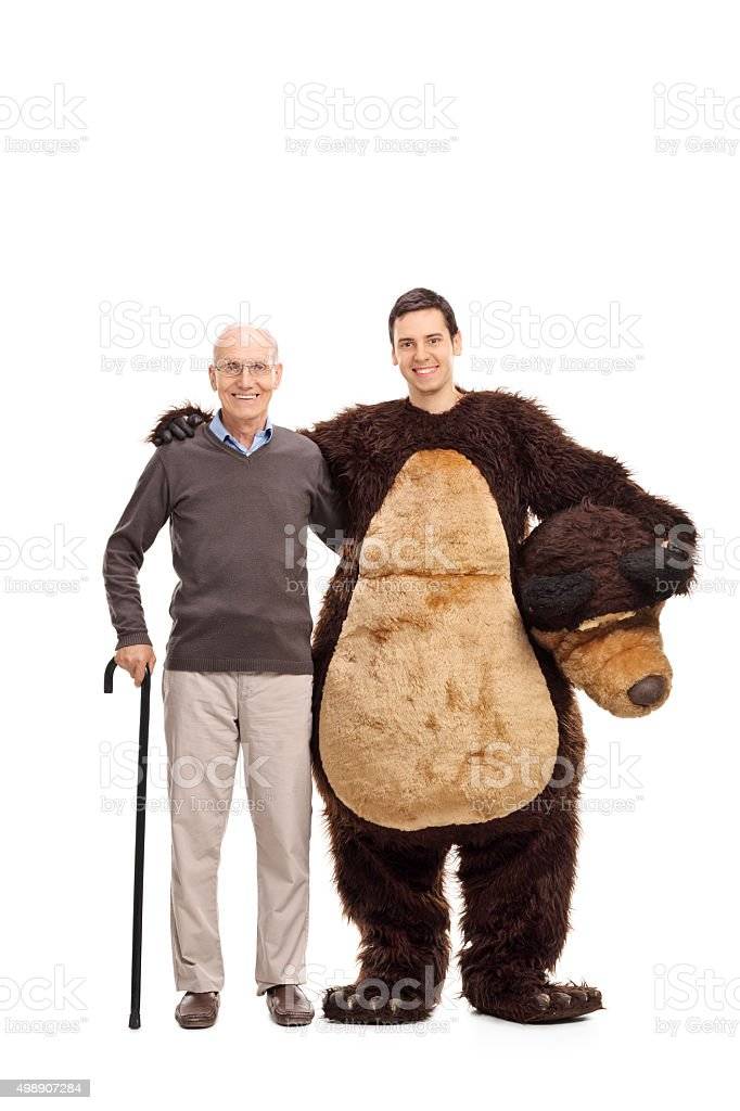 Senior posing with a guy in a bear costume stock photo