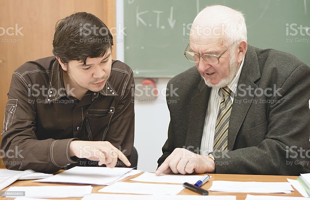 Senior professor discusses an issue with a student royalty-free stock photo
