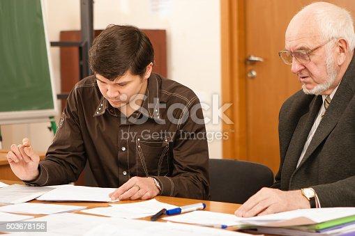 868148002 istock photo Senior professor examining the student's project 503678156