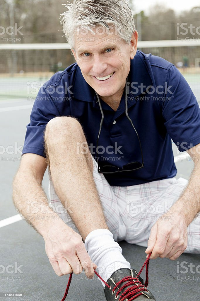 Senior Putting His Shoes On royalty-free stock photo