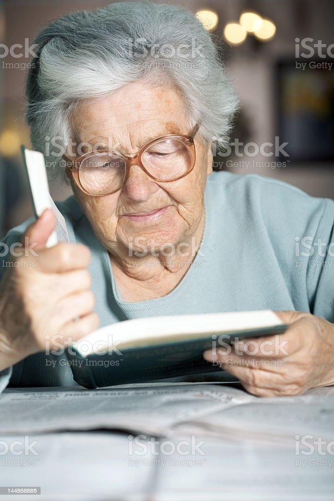 Senior reading a book royalty-free stock photo