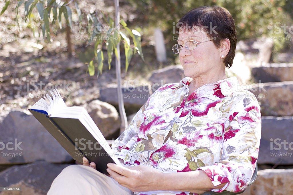 Senior Reading Book stock photo