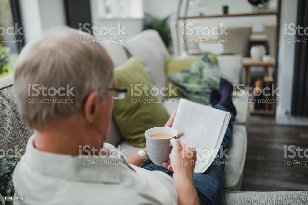 Senior Reading The Newspaper stock photo