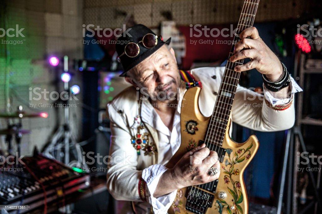 Senior Rock Guitarist in Recording Studio.