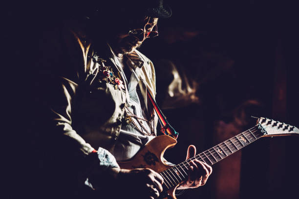 senior rock guitarist performing - musician stock photos and pictures