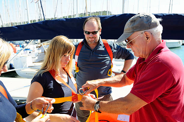 Senior Sailing Instructor Giving Safety Briefing stock photo