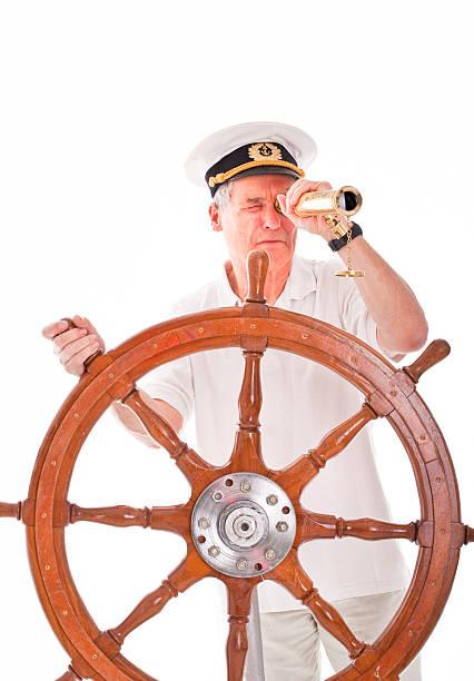 Senior avec un télescope marin - Photo