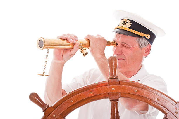 Senior sailor with telescope Senior sailor with telescope, isolated on white. Man with a vision. Business concept.  sailor suit stock pictures, royalty-free photos & images
