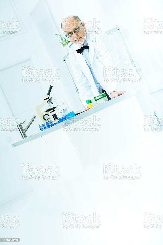 Senior scientist working in lab royalty-free stock photo