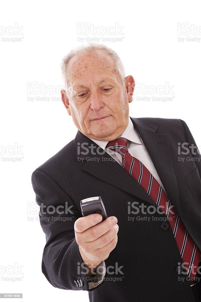 Senior sending a sms royalty-free stock photo