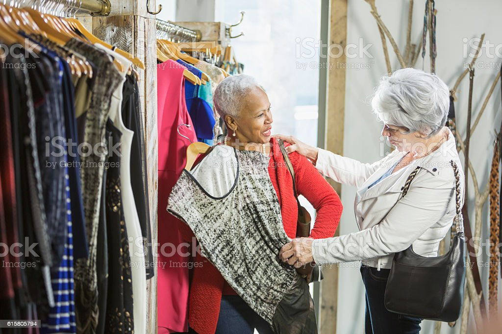 Senior shoppers in a clothing store looking at rack – Foto