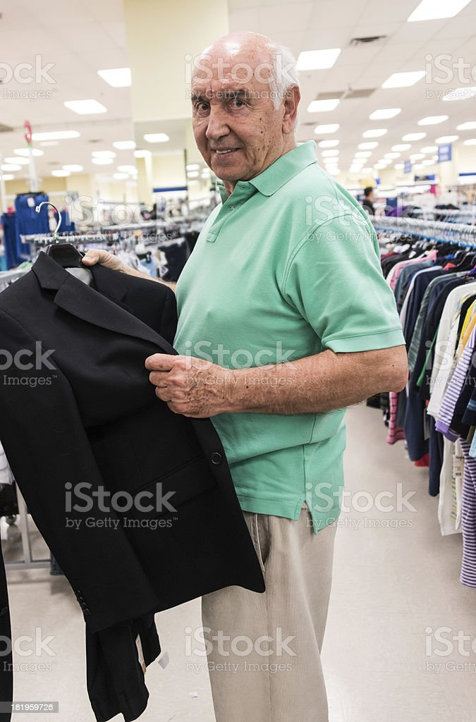 Senior shopping for clothes royalty-free stock photo
