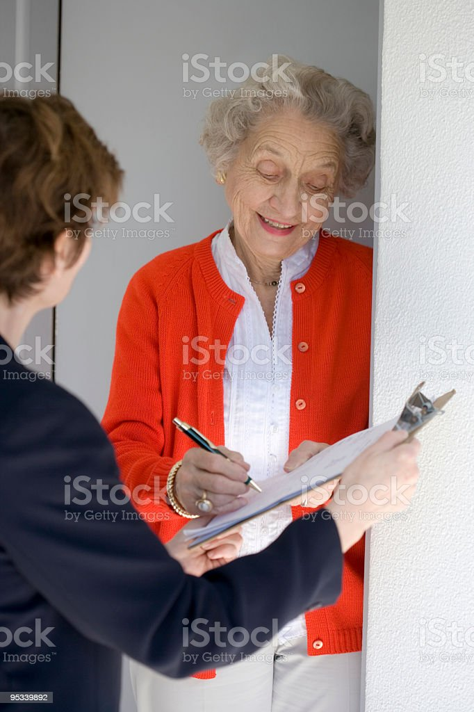 Senior signs a petition royalty-free stock photo