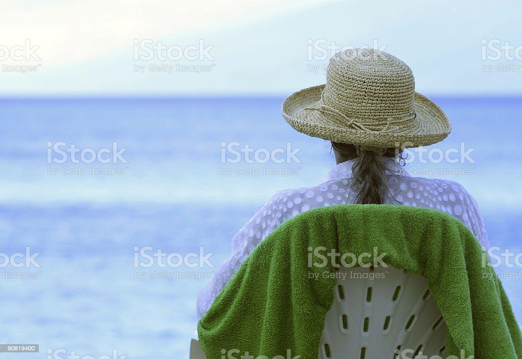 Senior Sitting at the Beach stock photo