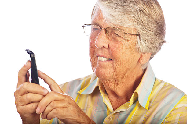 Senior Smart Phone User stock photo