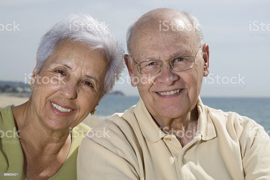 Senior smiling couple at the beach royalty-free stock photo