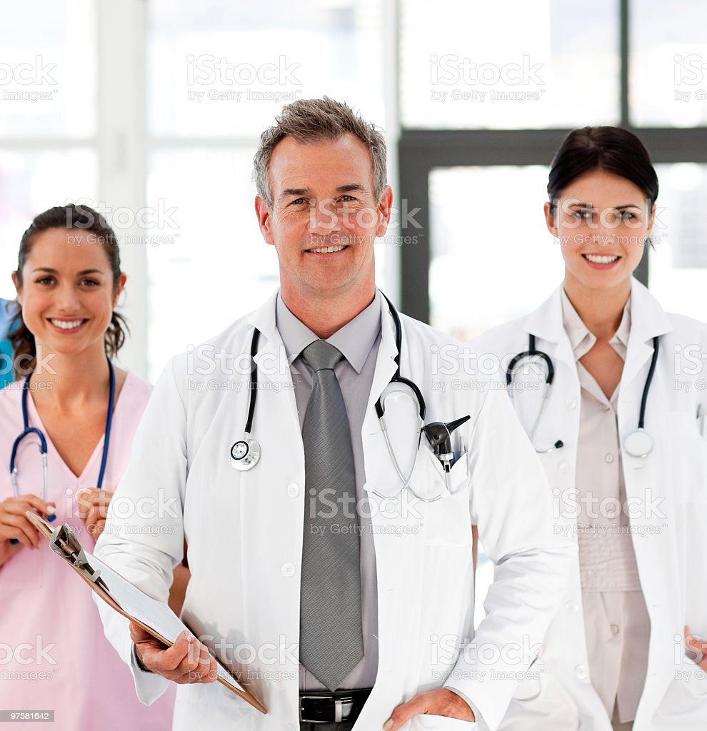 Senior Smiling doctor with his colleagues royalty-free stock photo
