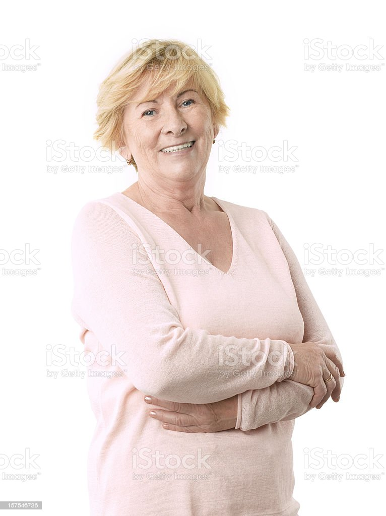 A senior smiling woman in a pink top stock photo