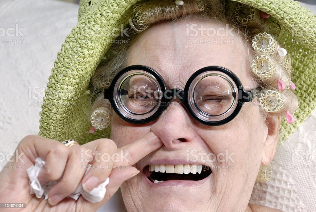 Senior Sniffles stock photo
