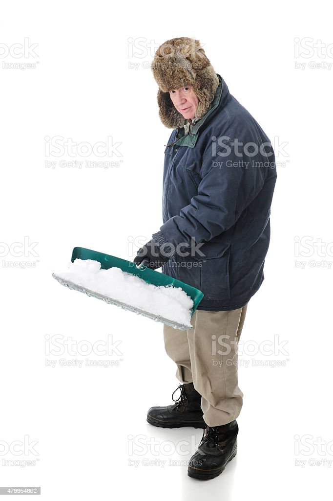 Senior Snow Shoveler stock photo