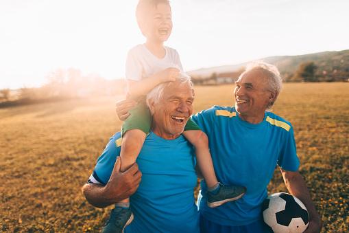 Senior soccer players and their grandson