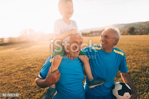 istock Senior soccer players and their grandson 831332140