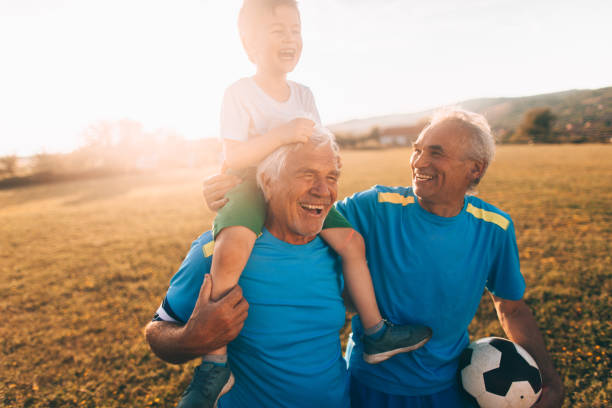 Senior soccer players and their grandson stock photo