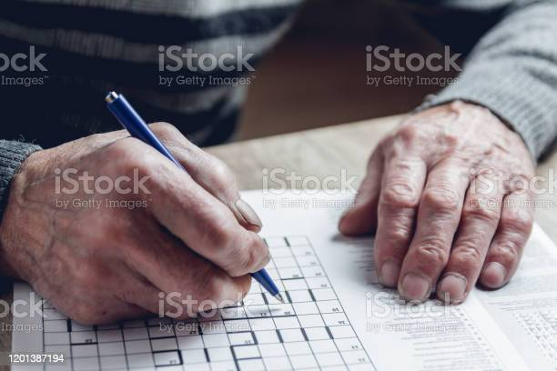 Senior solves sudoku or a crossword puzzle to slow the progressi picture id1201387194?b=1&k=6&m=1201387194&s=612x612&h=yp8waondsaf gbtcqoz f3vjgiq6or3d2vatv43gcd0=