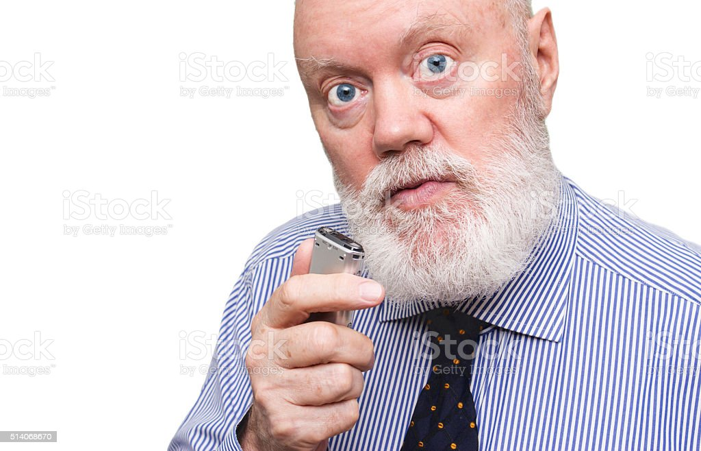 Senior speaking to voice recorder stock photo