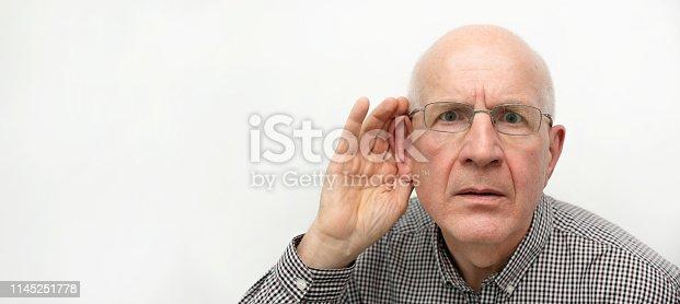 1029343276 istock photo Senior suffering from deafness 1145251778