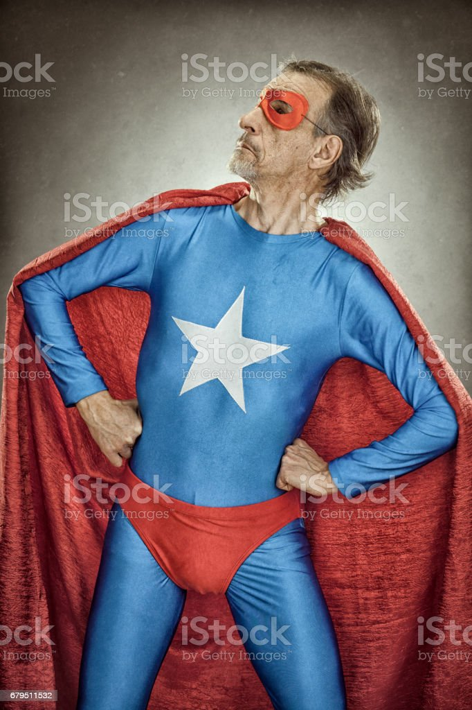 senior superhero man in blue costume red cloak and mask old portrait on textured background royalty-free stock photo