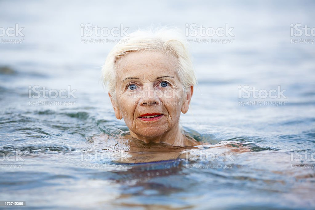 Senior Swimmer In The Sea royalty-free stock photo
