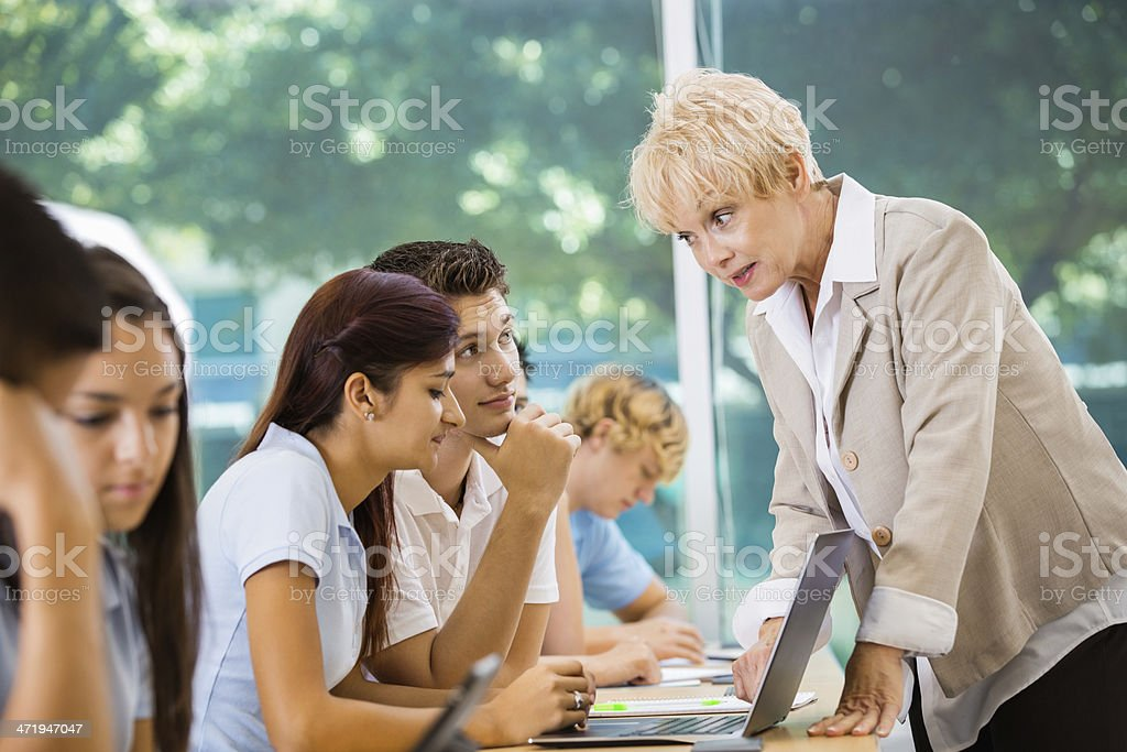 Senior teacher scolding high school students during class stock photo