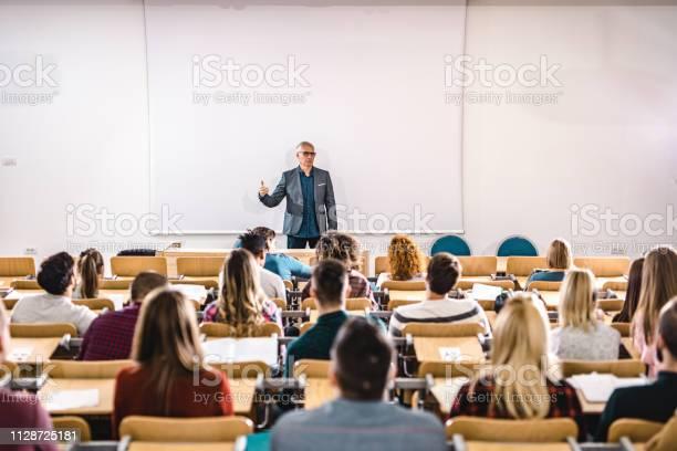Senior teacher talking to large group of college students in picture id1128725181?b=1&k=6&m=1128725181&s=612x612&h=xb3c e0nf39i7vu47ewxxfzmu0zvkin8o vn3mkiscs=