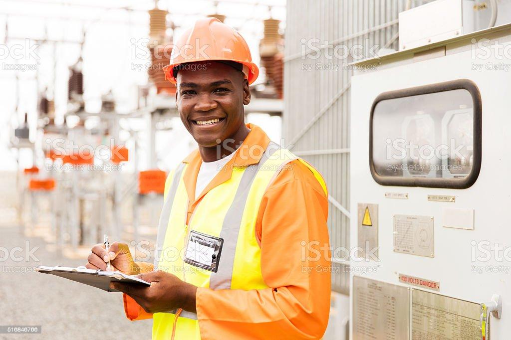 senior technician holding clipboard stock photo