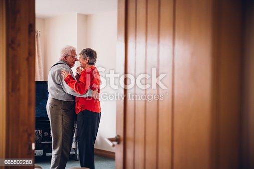 Senior couple dance in their Home.