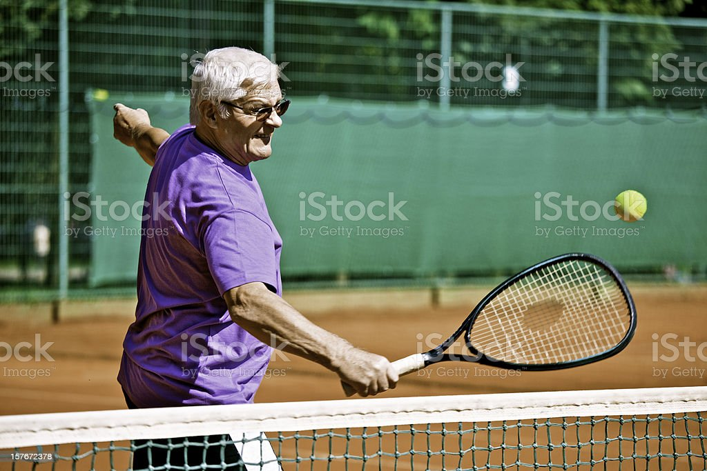 Senior Tennis Player on the Net royalty-free stock photo