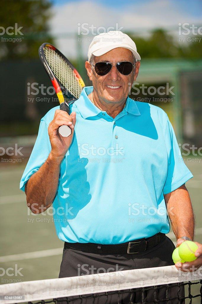 Senior tennis player portrait stock photo