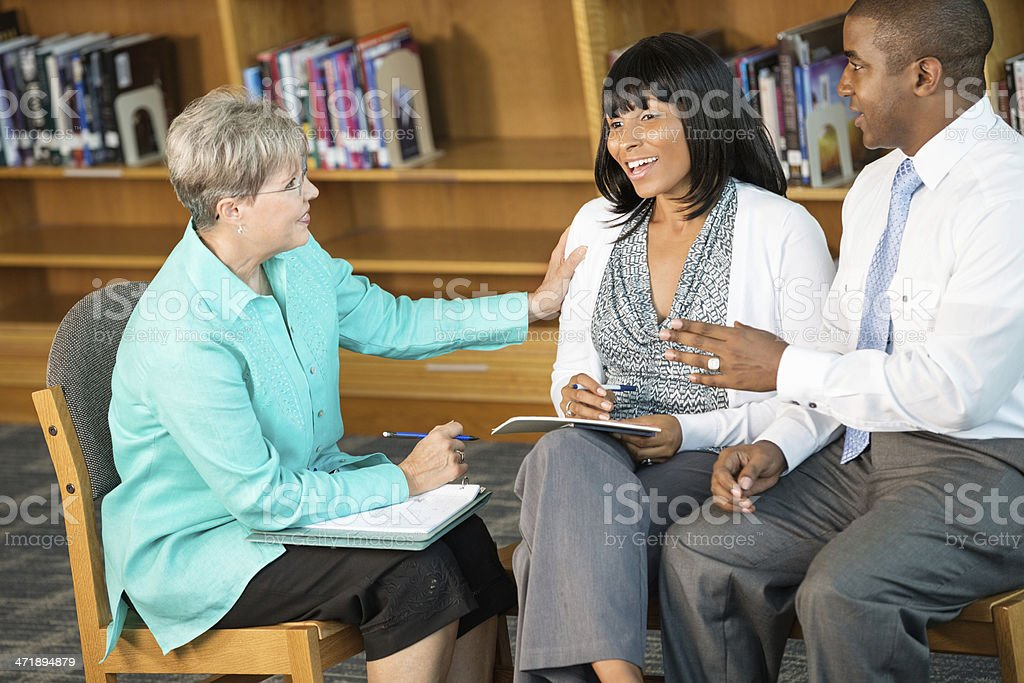 Senior therapist counseling husband and wife during meeting royalty-free stock photo