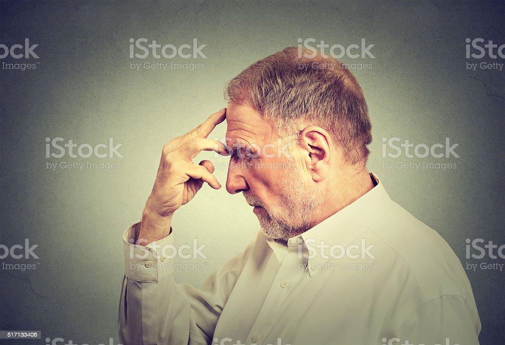senior thoughtful man stock photo