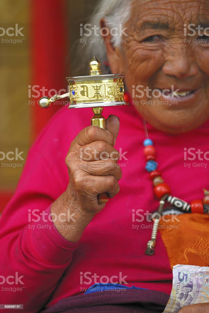 Senior Tibetan Prayer royalty-free stock photo