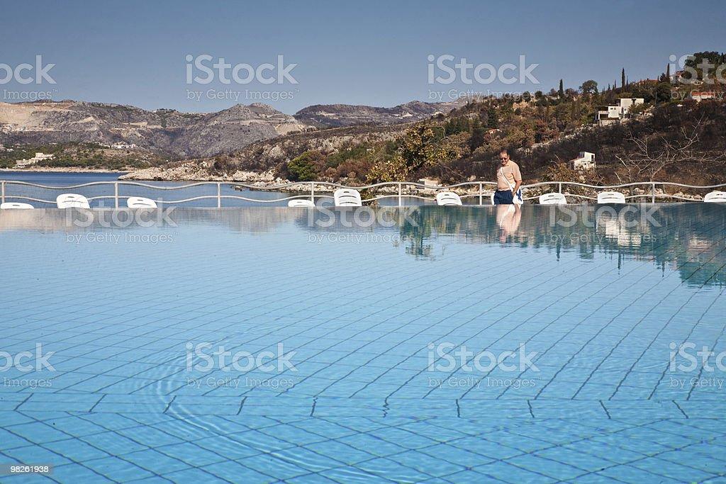 Senior tourist admires infinity pool in Croatia. royalty-free stock photo